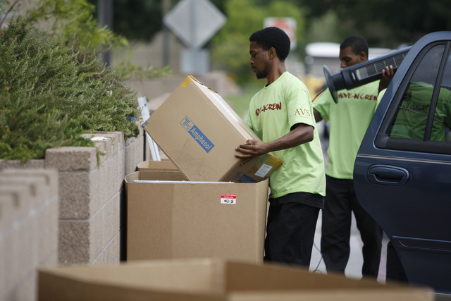 A crew helps students and their families unload their cars outside of Dayton Complex residence halls during freshmen move in day at UNLV in Las Vegas Wednesday, Aug. 20, 2014. (Erik Verduzco/Las V ...