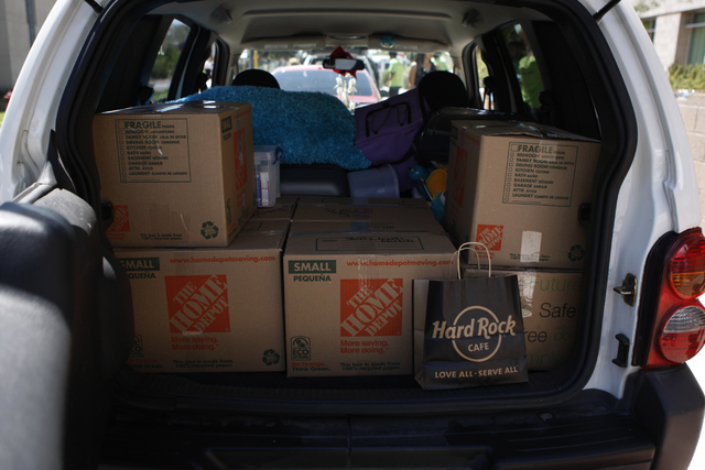 Belongings of Kiera Nielsen, 18, are seen waiting to be unloaded from her family's vehicle during move in day for freshmen at the Dayton Complex residence halls at UNLV in Las Vegas Wednesday, Aug ...