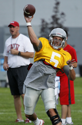 Quarterback Blake Decker (5) looks to pass during the opening day of UNLV's training camp up in Ely on Aug. 10, 2014. (Jason Bean/Las Vegas Review-Journal)