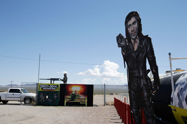 Painted signs are seen outside of the Last Stop outdoor shooting range Wednesday, Aug. 27, 2014, in White Hills, Ariz. Instructor Charles Vacca was accidentally killed Monday, Aug. 25, 2014, at th ...