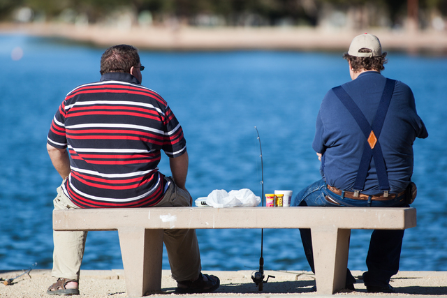 Cordell and John Eberhardt relax while fishing at Sunset Park in Las Vegas earlier this year. (Chase Stevens/Las Vegas Review-Journal)