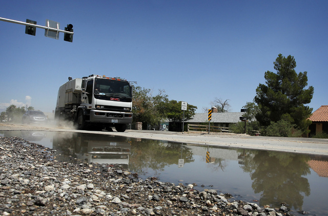 A street sweeper makes it's way south down Lindell Rd. near Eldora Ave. while cleaning debris off the roads the day after flash floods swept through the area on Tuesday, Aug. 5, 2014. (Jason Bean/ ...