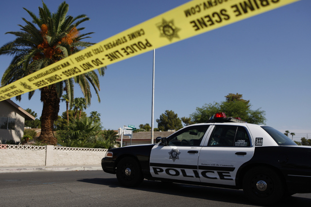 The scene of a home invasion and shooting at the corner of Autumn Street and Rollingwood Drive in Las Vegas Tuesday, July 29, 2014. (Erik Verduzco/Las Vegas Review-Journal)