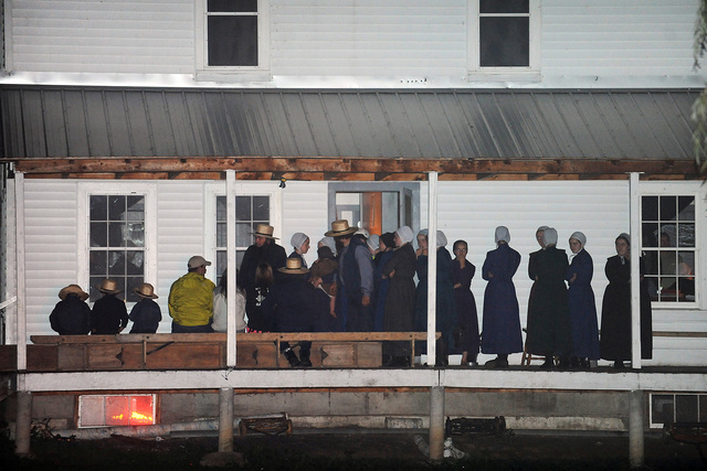 Supporters gather on the porch of a house at the intersection of Route 812 and Mt. Alone Road in Heuvelton, NY on Thursday, Aug. 14, 2014 after Fannie Miller, 12, and her sister Delila Miller, 6,  ...