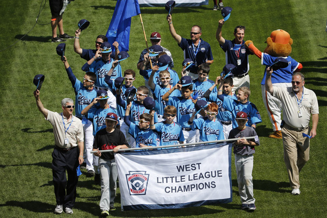 The Mountain Ridge Little League baseball team from Las Vegas participates in the opening ceremony of the 2014 Little League World Series tournament in South Williamsport, Pa., Thursday, Aug. 14,  ...