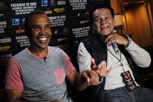 Boxing legends Sugar Ray Leonard, left, and Roberto Duran laugh together while helping to promote the Pacquiao vs. Rios fight at the Palazzo in Las Vegas on Nov. 22, 2013. (Jason Bean /Las Vegas R ...