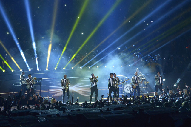 Bruno Mars performs performs during the halftime show of the NFL Super Bowl XLVIII  between the Seattle Seahawks and the Denver Broncos Sunday, Feb. 2, 2014, in East Rutherford, N.J. (AP Photo/Bil ...