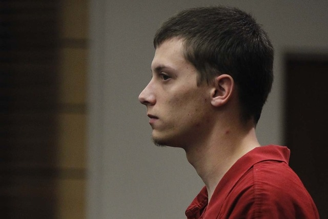 Defendant Colin Lowrey stands at attention during his court hearing at the Henderson Justice Court on Oct. 30, 2013.  (Jason Bean/Las Vegas Review-Journal)