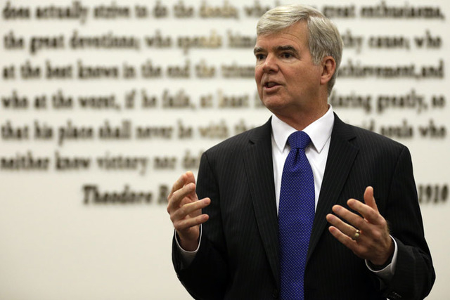 NCAA President Mark Emmert gestures while speaking at NCAA headquarters in Indianapolis on Thursday. The NCAA Board of Directors overwhelmingly approved a package of historic reforms Thursday that ...