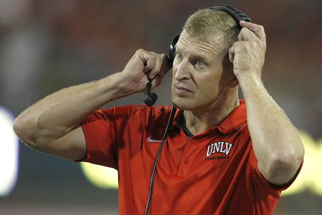 UNLV head coach Bobby Hauck during the first half of an NCAA college football game against Arizona, Friday, Aug. 29, 2014, in Tucson, Ariz. (AP Photo/Rick Scuteri)