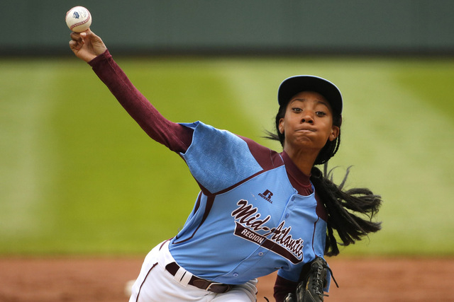 Pennsylvania's Mo'ne Davis delivers in the first inning against Tennessee during a baseball game in United States pool play at the Little League World Series tournament in South Williamsport, Pa., ...