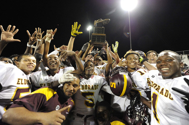 Eldorado Sun Devils players hoist the Cleat trophy after defeating the Chaparral Cowboys 28-21 druing a high school football game at Chaparral High School in Las Vegas Friday, August 29, 2014(Josh ...