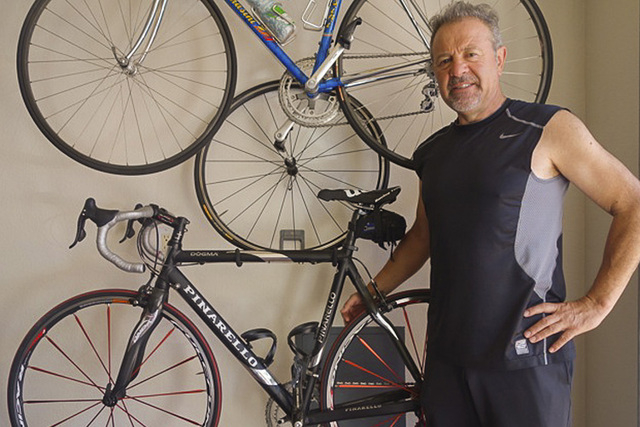 Chef Julian Serrano stands with the bike given to him by Robin Williams after they attended the Tour de France in the early 2000s. Serrano shared a 25-year friendship with Williams. (Norm Clarke/L ...