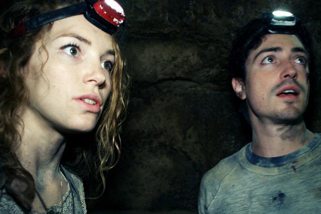 "Scarlett (PERDITA WEEKS) and George (BEN FELDMAN) traverse miles of twisting catacombs beneath the streets of Paris in ""As Above/So Below"".  (Courtesy)"