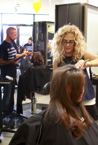More than 85 volunteers gathered at Square Salon, 1225 S. Fort Apache Road, No. 160, Aug. 10, to support the CASA Foundation's back-to-school event. The foundation received enough donated suppli ...