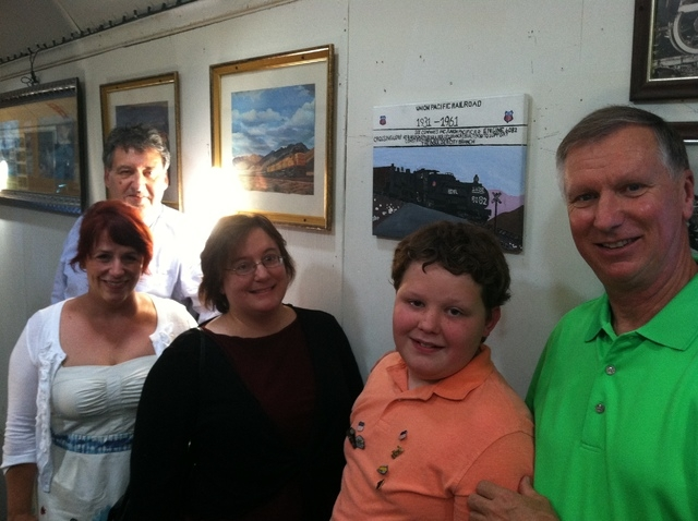New Horizons Academy student Haydn Haycocks was honored Aug. 1 at the Nevada State Railroad Museum in Boulder City for a painting he created for the museum, seen behind him, which was put on exhib ...