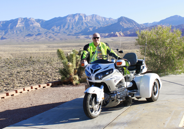 Retired Metropolitan Police Department employee Steve Fuquay pauses at Red Rock Canyon July 2 with his latest mode of transportation, a 2012 Honda Goldwing trike. He had not been on a motorcycle i ...
