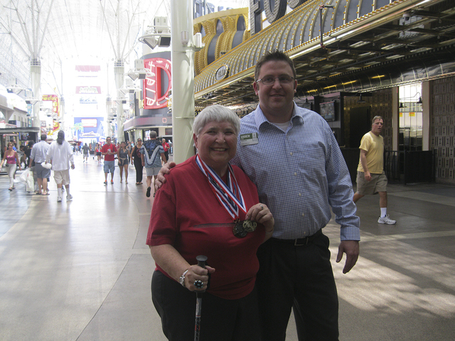 Lilias Gordon and Andrew Levin, executive director at Atria Seville, 2000 N. Rampart Blvd., beam July 8 after riding the SlotZilla Zip Line ride at the Fremont Street Experience. Atria Seville's ...