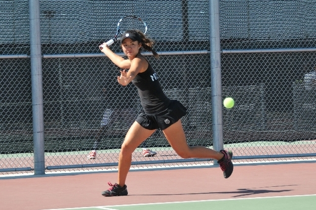 Kimberly Yee, 16, plays a tennis match May 10, 2013, at Lorenzi Park. Yee was awarded the nation's highest junior tennis award July 12 at the International Tennis Hall of Fame in Newport, R.I. ( ...