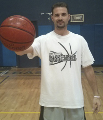 Coach Zach Cohen holds a basketball to demonstrate skills during a basketball clinic. The JCC of Southern Nevada has partnered with the Tarkanian Basketball Academy to announce the Ultimate 1-Day  ...