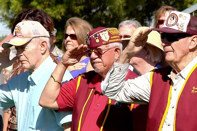 Members of the Las Vegas 7-11 Chapter of American Ex-Prisoners of War gathered with friends, family and Nellis Air Force Base airmen for a wreath-placing ceremony Friday, Sept 19, 2014, at Freedom ...
