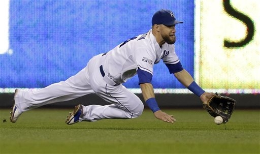 Kansas City Royals left fielder Alex Gordon cannot catch a ball that fell in for a single by Oakland Athletics' Josh Donaldson during the 11th inning of the AL wild-card playoff baseball game Tues ...