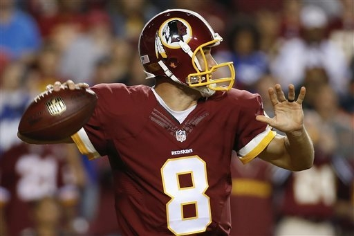 Washington Redskins quarterback Kirk Cousins readies to pass the ball during the first half of an NFL football game against the New York Giants in Landover, Md., Thursday, Sept. 25, 2014. (AP Phot ...