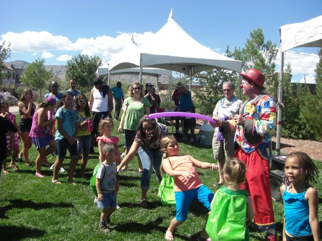 Children play during Providence community's annual Sunny 106.5-FM Ice Cream Sunday, in September 2011. This year's event is set from 11 a.m. to 2 p.m. Sept. 28 at the Providence community's  ...