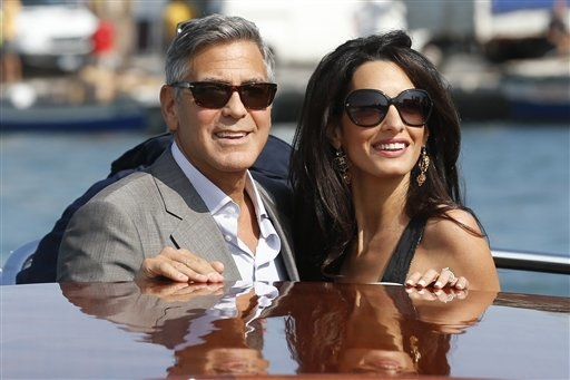 George Clooney, left, and Amal Alamuddin arrive in Venice, Italy, Friday, Sept. 26, 2014. Clooney, 53, and Alamuddin, 36, are expected to get married this weekend in Venice, one of the worlds most ...