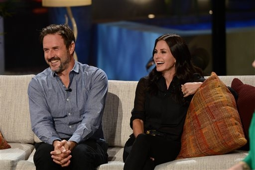 """This undated photo provided by FremantleMedia North America & Debmar-Mercury shows producers, David Arquette, left, and Courtney Cox, on their show, """"Celebrity Name Game,"""" hosted by Crai ..."""