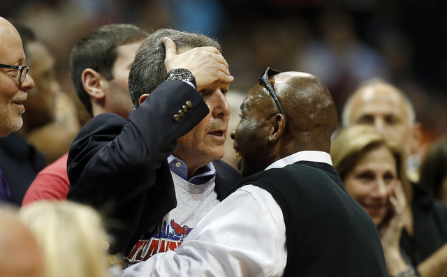 Atlanta Hawks managing partner Bruce Levenson, center, reacts after a close call in the second half of Game 3 of an NBA basketball first-round playoff series  against the Indiana Pacers, Thursday, ...