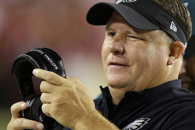 Philadelphia Eagles head coach Chip Kelly winks as he watchers the action on the field during the second half of an NFL football game against the Washington Redskins in Landover, Md., Monday, Sept ...