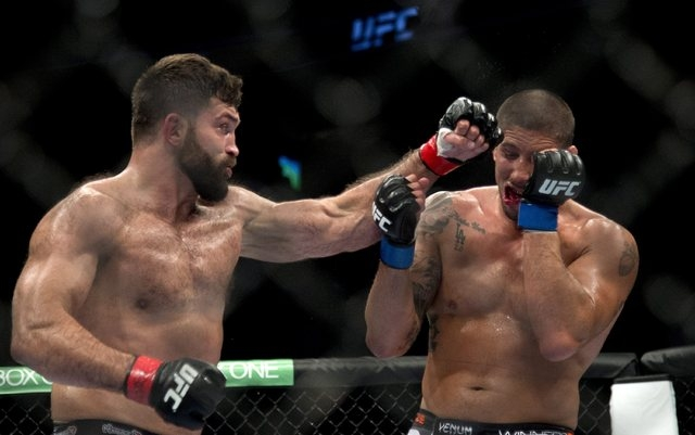 Andrei Arlovski, left, punches Brendan Schaub, of the United States, during a heavyweight bout at UFC 174 in Vancouver, British Columbia, Saturday, June, 14, 2014. (AP Photo/The Canadian Press, Jo ...