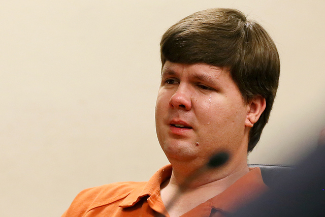 A tear rolls down the cheek of Justin Ross Harris, the father of a toddler who died after police say he was left in a hot car for about seven hours, as he sits during his bond hearing in Cobb Coun ...