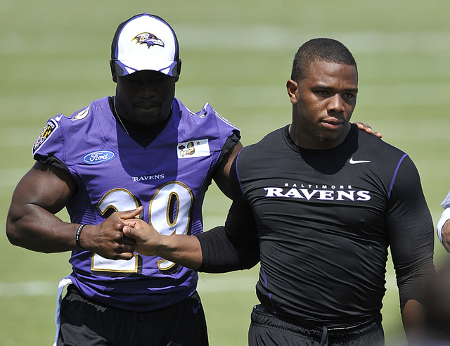 Baltimore Ravens running back Ray Rice, right, walks off the field with Justin Forsett before addressing the media in a news conference after NFL football training camp practice, Thursday, July 31 ...