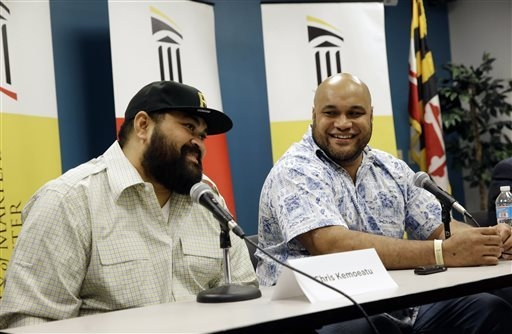 Chris Kemoeatu, left, and his brother Ma'ake laugh during a news conference at the University of Maryland Medical Center, Wednesday, Sept. 17, 2014, in Baltimore. Chris Kemoeatu's football career  ...