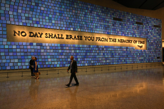 This photo shows a quote from Virgil on a wall of the museum prior to the dedication ceremony at the National September 11 Memorial Museum in New York. More than 700,000 people have visited the 9/ ...