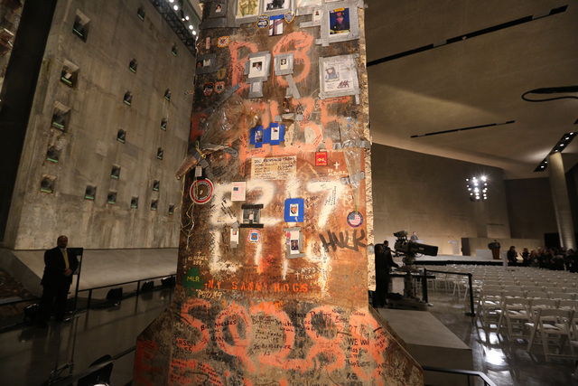 This file photo shows a steel beam from the World Trade Center at the center of Foundation Hall  in New York. More than 700,000 people have visited the museum since it opened in May.  (AP Photo/Th ...
