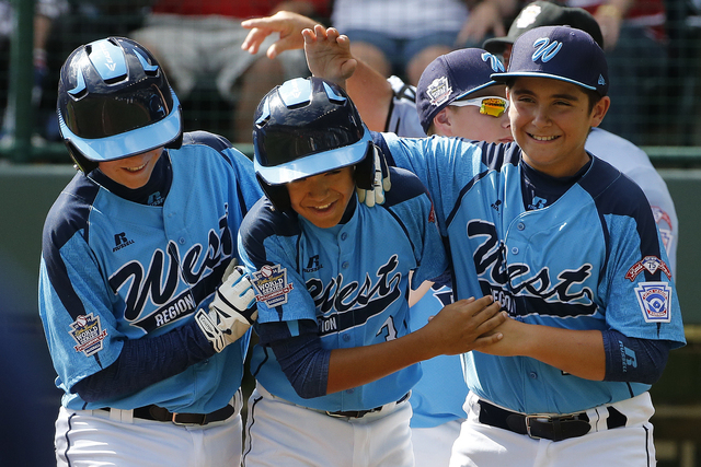 Las Vegas' Dominic Clayton, center, celebrates with teammates Josh Zuehlsdorff, left, and Dillon Jones after hitting a two-run home run off Chicago pitcher Cameron Bufford during the fourth inning ...