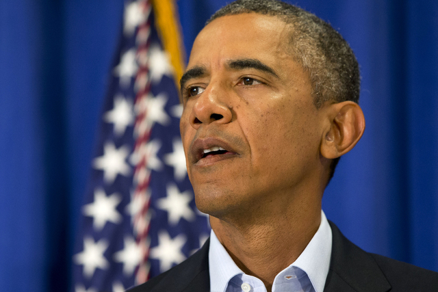 President Barack Obama speaks in Edgartown, Massachusetts, Aug. 20, 2014, about the killing of American journalist James Foley by militants with the Islamic State extremist group. (AP Photo/Jacque ...
