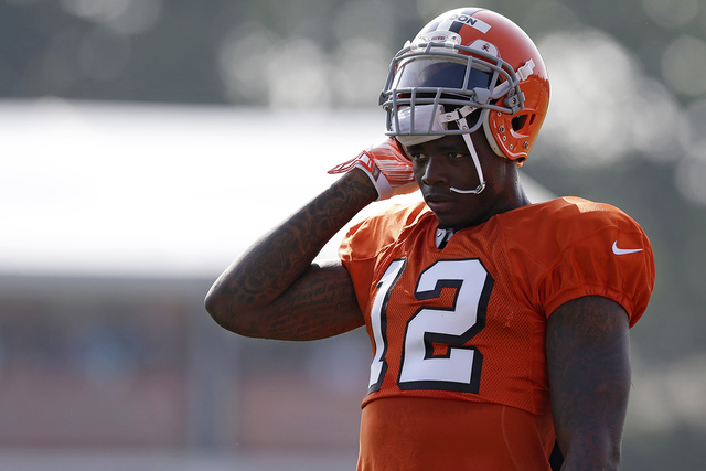 In this Aug. 4, 2014, file photo, Cleveland Browns wide receiver Josh Gordon rests during practice at the NFL football team's training campin Berea, Ohio. (AP Photo/Tony Dejak, File)