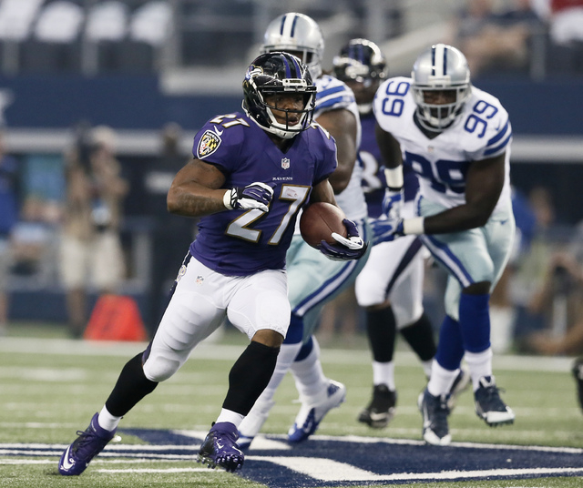 In this Aug. 16, 2014, photo, Baltimore Ravens running back Ray Rice (27) carries during an NFL preseason football game against the Dallas Cowboys in Arlington, Texas. Ravens running back Ray Rice ...