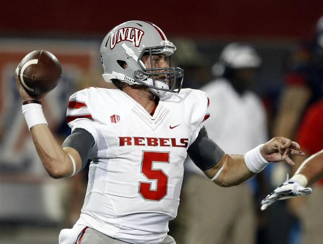 UNLV quarterback Blake Decker (5) during the first half of an NCAA college football game against Arizona, Friday, Aug. 29, 2014, in Tucson, Ariz. (AP Photo/Rick Scuteri)