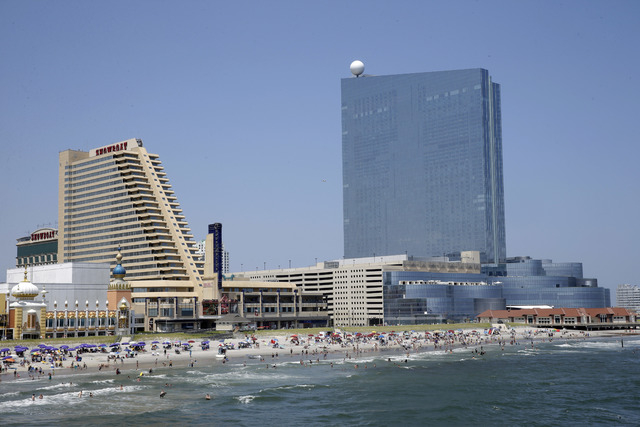 FILE - This July 23, 2014, file photo, shows the Showboat Casino Hotel, left, and the Revel Casino Hotel along the Boardwalk in Atlantic City, N.J. Revel is shutting down a little over two years a ...