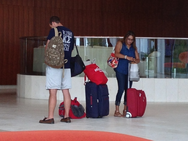 Hotel guests gather their luggage after checking out of Revel Casino Hotel in Atlantic City N.J. on Monday, Sept. 1, 2014, shortly before it shut down its hotel. The $2.4 billion resort failed aft ...
