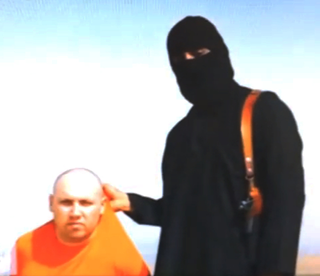 In this  file still image from an undated video released by Islamic State militants on Tuesday, Aug. 19, 2014, purports to show journalist Steven Sotloff being held by the militant group. An Inter ...