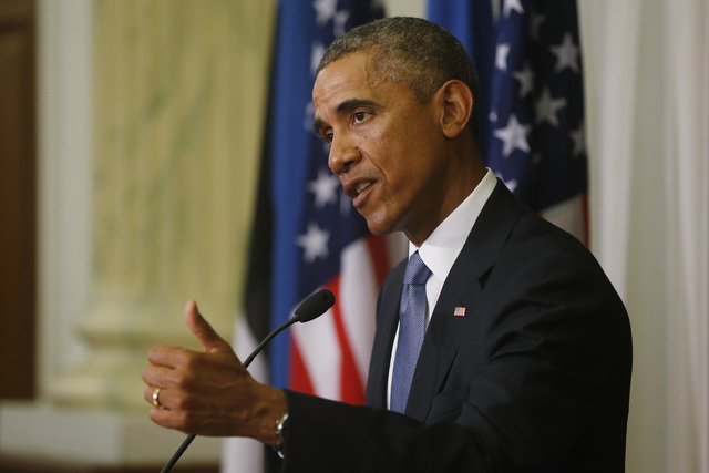 U.S. President Barack Obama speaks during a news conference with Estonian President Toomas Hendrik Ilves at the Bank of Estonia in Tallinn, Estonia, Wednesday, Sept. 3, 2014. Obama is in Estonia f ...