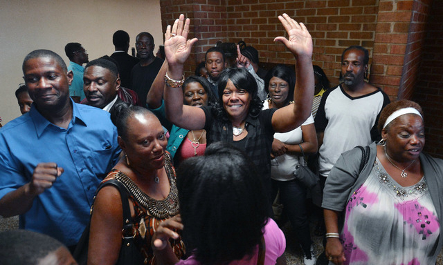 Geraldine Brown, sister of Leon Brown, celebrates outside a Robeson County courtroom where her brothers were declared innocent of the rape and murder of an 11 year old girl in 1983, Tuesday, Sept. ...