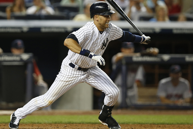 New York Yankees' Derek Jeter leaves the batter's box with a fifth-inning RBI single during a baseball game against the Boston Red Sox at Yankee Stadium in New York, Tuesday, Sept. 2, 2014. Brian  ...