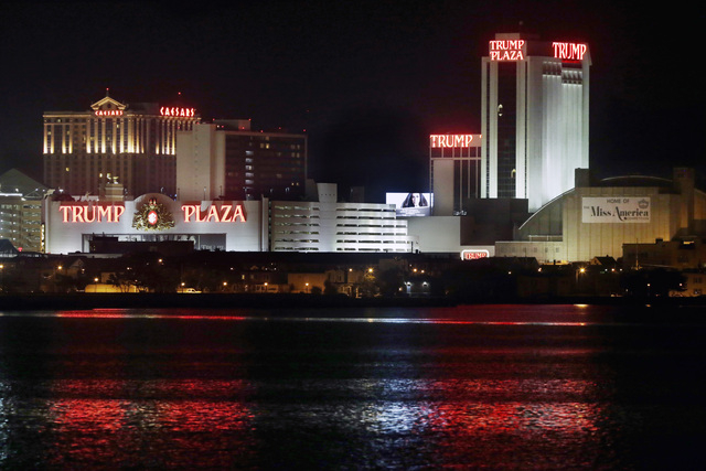 The Trump Plaza Hotel Casino is illuminated at night early Tuesday, Sept. 2, 2014, in Atlantic City, N.J. Trump Plaza received final state approval Tuesday to close on Sept. 16, 2014. Atlantic Cit ...
